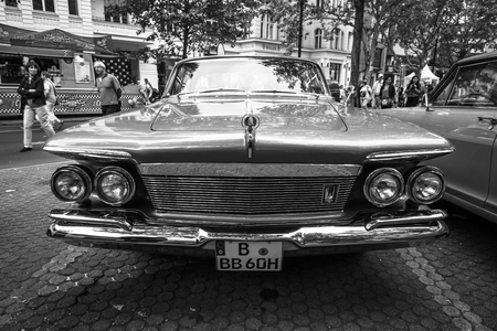 custom car: BERLIN - JUNE 14, 2015: Luxury car Imperial Custom 4-door Southampton, 1961. Black white. The Classic Days on Kurfuerstendamm.