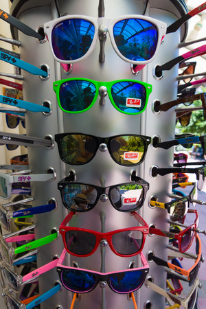 internationally: AVSALLAR, TURKEY - JULY 01, 2015: Sunglasses Ray-Ban. Background. Ray-Ban is a internationally well-known brand of sunglasses and eyeglasses founded in 1937.