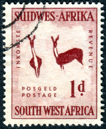 southwest: SOUTH-WEST AFRICA - CIRCA 1954: Postage stamp printed in South-West Africa, shows Gazelles, rock paintings in Brandberg Mountain, circa 1954 Editorial
