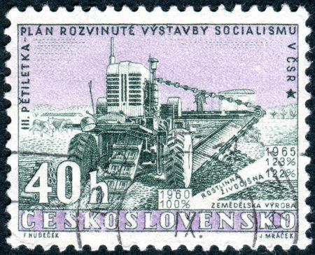 publicize: CZECHOSLOVAKIA - CIRCA 1960: Postage stamp printed in Czechoslovakia, Issued to publicize the new five-year plan, shows Harvester, circa 1960