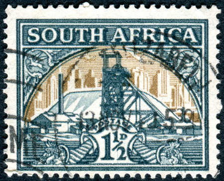 gold mine: SOUTH AFRICA - CIRCA 1936: Postage stamp printed in South Africa, shows Gold Mine, circa 1936