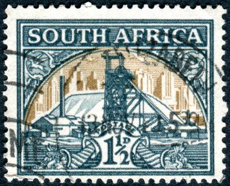 goldmine: SOUTH AFRICA - CIRCA 1936: Postage stamp printed in South Africa, shows Gold Mine, circa 1936