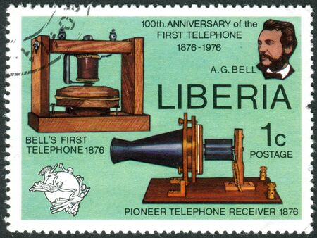 upu: LIBERIA - CIRCA 1976: Postage stamp printed in Liberia, is devoted to Cent. of 1st telephone call by Alexander Graham Bell, shows AG Bell, Telephone and Receiver, UPU Emblem, circa 1976 Editorial