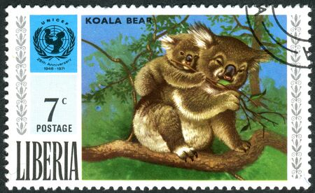 unicef: LIBERIA - CIRCA 1971: Postage stamp printed in Liberia, the 25th anniversary of UNICEF, shows Koala and UNICEF Emblem, circa 1971 Editoriali