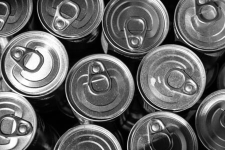 beer can: Metal cans. Top view. Close-up. Black and white. Stock Photo