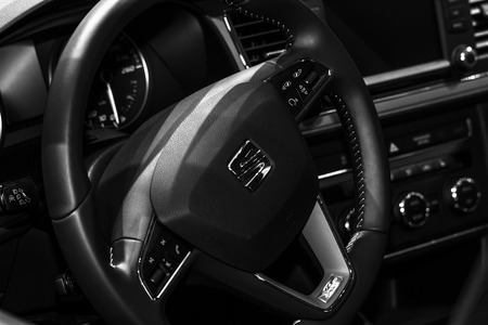 BERLIN - AUGUST 08, 2015: Showroom. Steering wheel of a crossover SEAT Leon X-PERIENCE. Produced since 2014. Black and white. Editorial