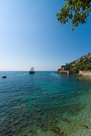 cerulean: ALANYA, TURKEY - JULY 04, 2015: Shipyard (Tersane) and the ruins of a medieval fortress (Alanya Castle) on the mountainside. Editorial