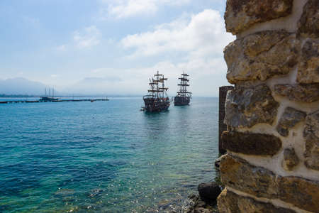 alanya: ALANYA, TURKEY - JULY 04, 2015: Mediterranean Sea. Traditional entertainment resort of Alanya. Sailing aka pirate ships around the fortress of Alanya.