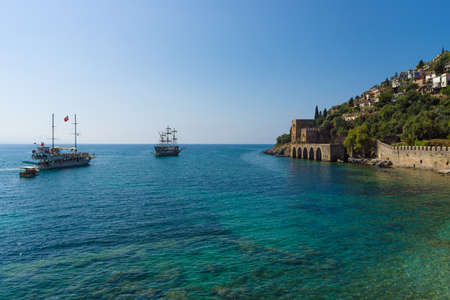 mountainside: ALANYA, TURKEY - JULY 04, 2015: Shipyard (Tersane) and the ruins of a medieval fortress (Alanya Castle) on the mountainside. Editorial