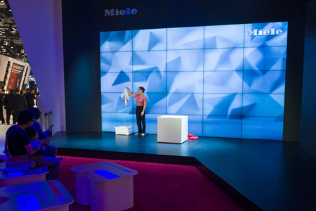 household appliances: BERLIN - SEPTEMBER 04, 2015: Stand of manufacturer of household appliances Miele. International radio exhibition Berlin (IFA2015).