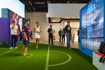exhibition stand: BERLIN - SEPTEMBER 04, 2015: Stand of company Beko. Interactive game of football. International radio exhibition Berlin (IFA2015).