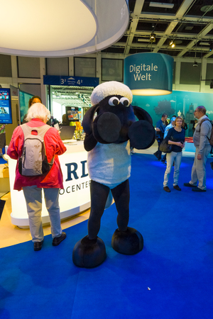 ard: BERLIN - SEPTEMBER 04, 2015: Pavilion of the German television company ARD and character cartoons Shaun the Sheep. International radio exhibition Berlin (IFA2015).
