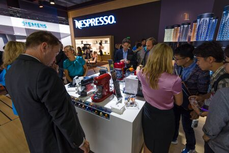 BERLIN - SEPTEMBER 04, 2015: Visitors taste the coffee from the Nespresso. International radio exhibition Berlin (IFA2015).
