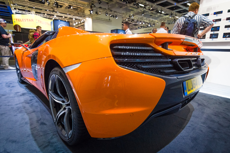 supercar: BERLIN - SEPTEMBER 04, 2015: Supercar McLaren 650S Spider. Rear view. International radio exhibition Berlin (IFA2015).