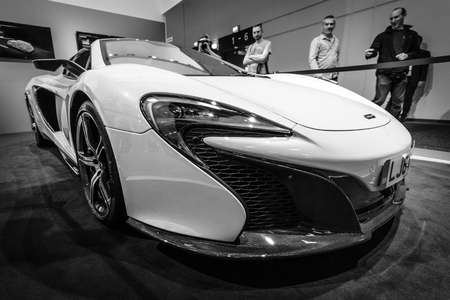 supercar: BERLIN - SEPTEMBER 04, 2015: Supercar McLaren 650S Spider. Black and white. International radio exhibition Berlin (IFA2015). Editorial