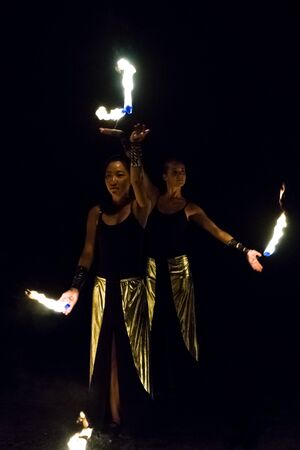 vacationers: AVSALLAR, TURKEY - JUNE 30, 2015: Fire show. Evening performance on the beach for vacationers. Anatolian coast - a popular holiday destination in summer of European citizens. Editorial
