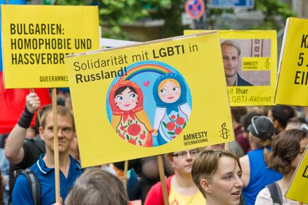 discrimination: BERLIN, GERMANY - JUNE 27, 2015: Christopher Street Day (CSD). The annual European LGBT celebration and demonstration held in Berlin for the rights of LGBT people, and against discrimination and exclusion.