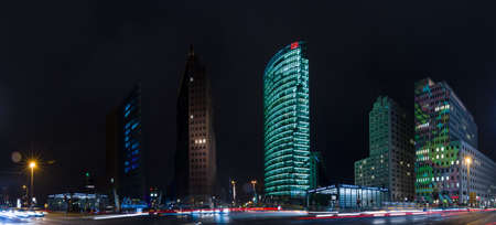platz: BERLIN, GERMANY - OCTOBER 13, 2015: Skyscrapers on Potsdamer Platz to night lighting, the annual Festival of Light 2015. Panoramic view.