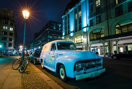 panel van: BERLIN, GERMANY - OCTOBER 13, 2015: Full-size pickup truck Ford F100 Panel Van, 1953 (second generation) on the night street. Ford F-Series - is a popular American pickup.