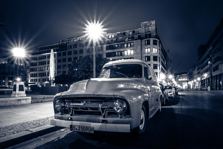 panel van: BERLIN, GERMANY - OCTOBER 13, 2015: Full-size pickup truck Ford F100 Panel Van, 1953 (second generation) on the night street. Stylization. Toning. Ford F-Series - is a popular American pickup. Editorial