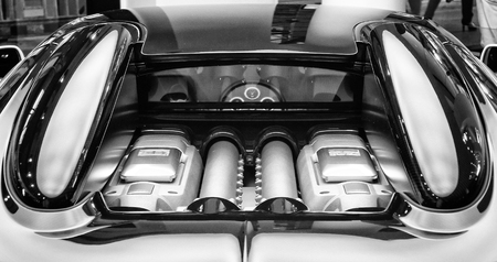 engine compartment: BERLIN - SEPTEMBER 04, 2012: Showroom. The engine compartment of the Bugatti Veyron EB 16.4 is a mid-engined grand touring car. Black and white. Bugatti Veyron - the fastest car in the world.