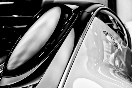 fastest: BERLIN - SEPTEMBER 04, 2012: Showroom. Fragment of the Bugatti Veyron EB 16.4 is a mid-engined grand touring car. Black and white. Bugatti Veyron - the fastest car in the world.