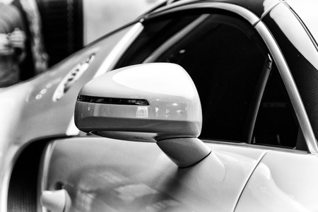 rear view mirror: BERLIN - SEPTEMBER 04, 2012: Showroom. Detail (rear view mirror) of a Bugatti Veyron EB 16.4 is a mid-engined grand touring car. Black and white. Bugatti Veyron - the fastest car in the world.