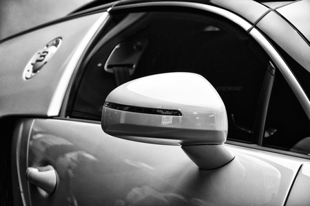 rear view mirror: BERLIN - AUGUST 31, 2012: Showroom. Detail (rear view mirror) of a Bugatti Veyron EB 16.4 is a mid-engined grand touring car. Black and white. Bugatti Veyron - the fastest car in the world.