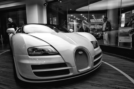 fastest: BERLIN - AUGUST 31, 2012: Showroom. The Bugatti Veyron EB 16.4 is a mid-engined grand touring car. Black and white. Bugatti Veyron - the fastest car in the world. Editorial