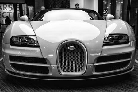 BERLIN - AUGUST 31, 2012: Showroom. The Bugatti Veyron EB 16.4 is a mid-engined grand touring car. Black and white. Bugatti Veyron - the fastest car in the world. Editoriali