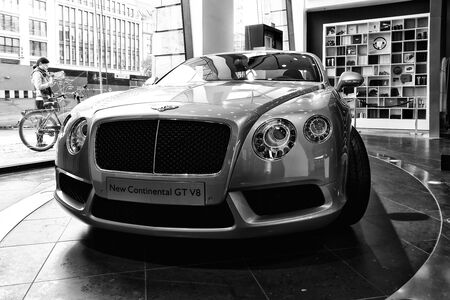 v8: BERLIN - AUGUST 31, 2012: Showroom. Personal luxury car Bentley New Continental GT V8. Black and white. Produced since 2013.