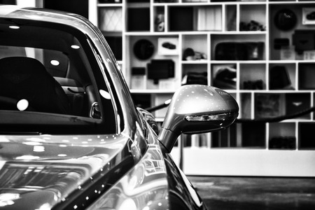 rear view mirror: BERLIN - AUGUST 31, 2012:  Showroom. Detail (rear view mirror) of a personal luxury car Bentley New Continental GT V8. Black and white. Produced since 2013.