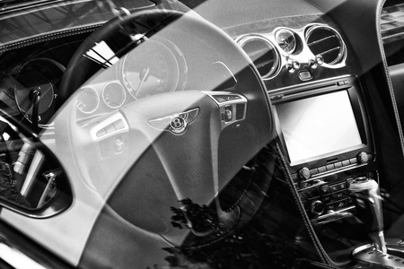 v8: BERLIN - AUGUST 31, 2012: Showroom. The interior of a full-size luxury car Bentley New Continental GT V8 coupe. Black and white. Produced since 2013. Editorial
