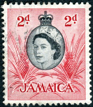 jamaica: JAMAICA - CIRCA 1956: Postage stamp printed in Jamaica, shows a portrait of Queen Elizabeth II and Pineapple, circa 1956
