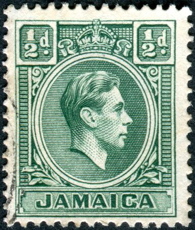jamaica: JAMAICA - CIRCA 1938: Postage stamp printed in Jamaica, shows a portrait of King George VI, circa 1938 Editorial