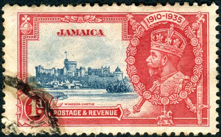 jamaica: JAMAICA - CIRCA 1935: Postage stamp printed in Jamaica, shows King George V and Windsor Castle, circa 1935 Editorial