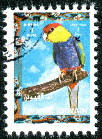 umm: UMM AL-QUWAIN - CIRCA 1972: Postage stamp printed in Umm al-Quwain, show bird Red-capped Parrot Purpureicephalus spurius, circa 1972