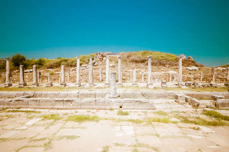 colonnaded: Ancient ruins of Perge. The colonnaded street. Stylized color film. Toning. Turkey