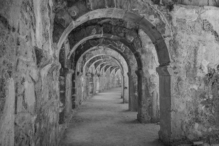stylization: Internal passages in the ancient Roman amphitheater of Aspendos. The province of Antalya. Mediterranean coast of Turkey. Black and white. Stylization. Stock Photo