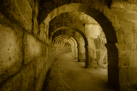 passages: Internal passages in the ancient Roman amphitheater of Aspendos. The province of Antalya. Mediterranean coast of Turkey. Vintage toning. Stylization.