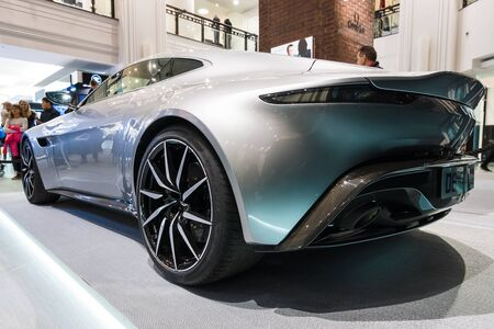 spectre: BERLIN - OCTOBER 26, 2015: Grand tourer Aston Martin DB10. Rear view. The exhibition in the trading house KaDeWe as part of a promotional tour of the new film about James Bond Spectre Editorial
