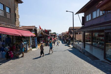 citizens: SIDE, TURKEY - JULY 07, 2015: The shopping street. Anatolian coast - a popular holiday destination in summer of European citizens.