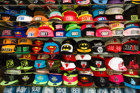 baseball caps: SIDE, TURKEY - JULY 07, 2015: Baseball caps with different brand names. Shop on the waterfront. Anatolian coast - a popular holiday destination in summer of European citizens.