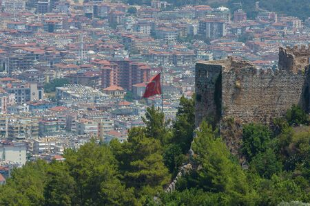 alanya: Turkish flag on the background of houses of the central district of Alanya. View from the ancient fortress of Alanya.