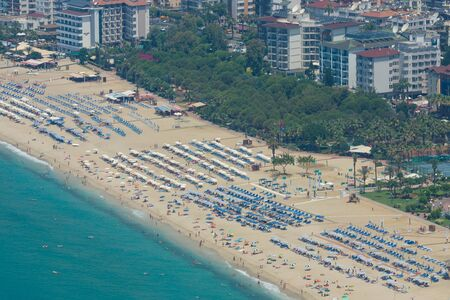 alanya: ALANYA, TURKEY - JULY 09, 2015: The city beach in Alanya. The view from the birds eye view. Alanya - a popular holiday destination for European tourists. Editorial