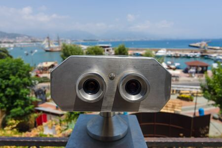 sighting: Sighting place with a view of the sea port. Binocular close-up in the foreground.