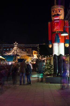 spandau: BERLIN - DECEMBER 08, 2015: The traditional Christmas market in the Old Spandau. Nutcracker in the foreground. Editorial
