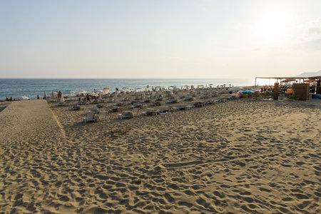 alanya: ALANYA, TURKEY - JULY 07, 2015: The famous sandy beach of Cleopatra city at sunset.