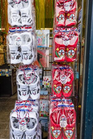 klompen: MAASTRICHT, NETHERLANDS - JANUARY 13, 2016: Sale of souvenirs. Traditional Dutch wooden shoes - klompen. Editorial