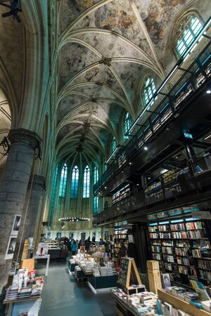 book racks: MAASTRICHT, NETHERLANDS - JANUARY 13, 2016: Dominican Church of the 13th century, after the restoration in 2005 using the premises as a bookstore.